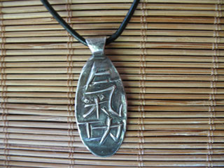 Oval QIGONG on Leather Necklace